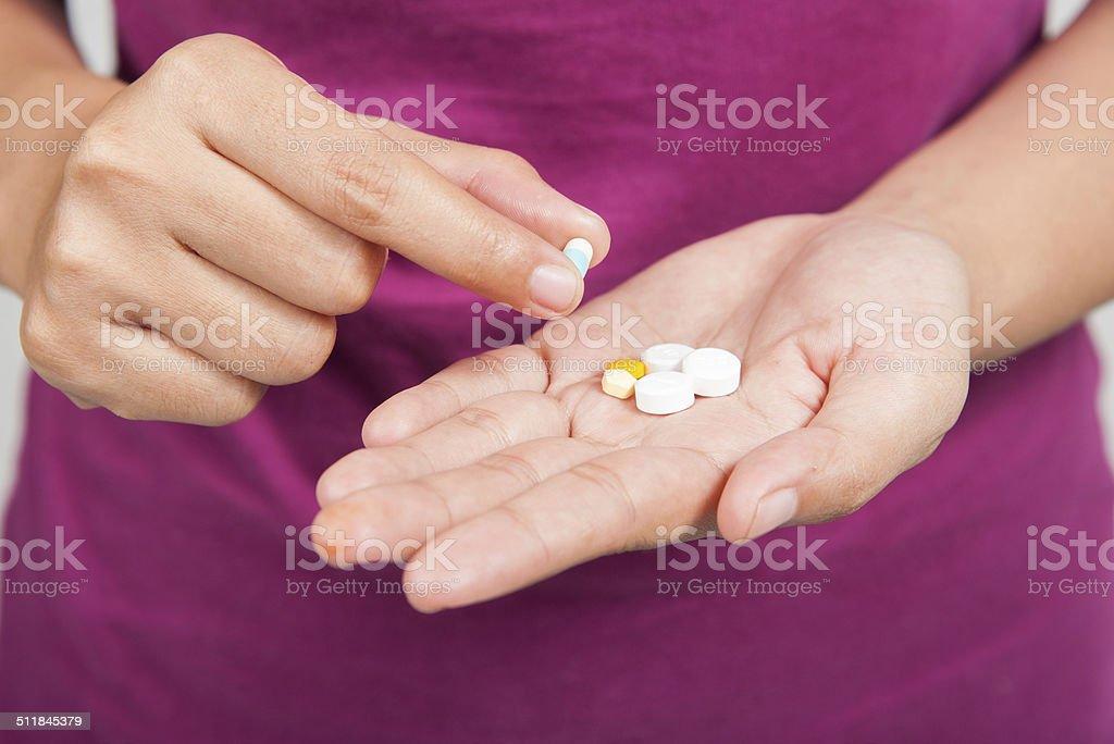 pills in hand stock photo
