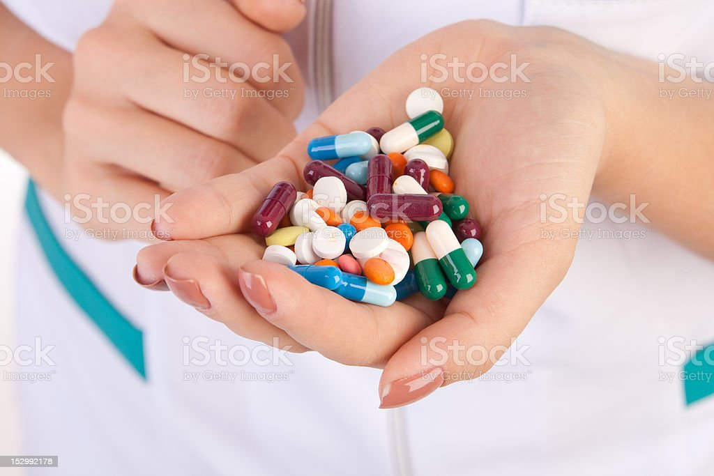 pills in hands of doctor royalty-free stock photo