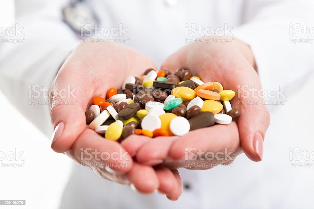 Pills in hands of doctor stock photo