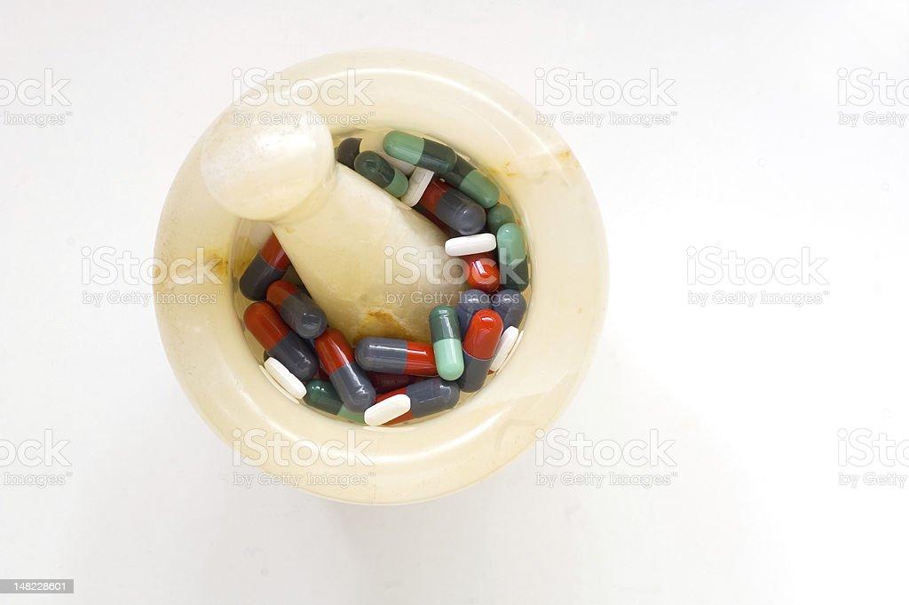 Pills in mortar royalty-free stock photo