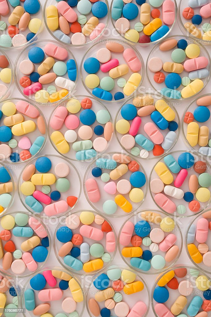 Pills in petri dishes royalty-free stock photo