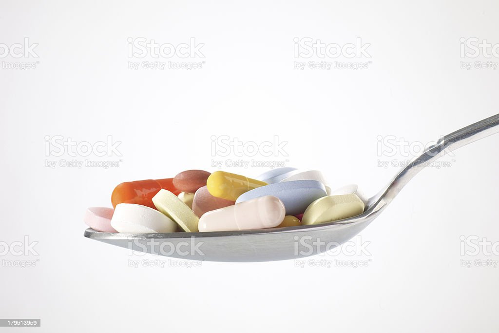 Pills In Spoon royalty-free stock photo