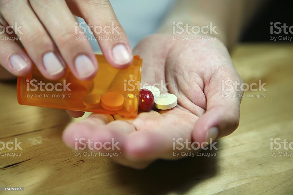 Pills in the hand stock photo