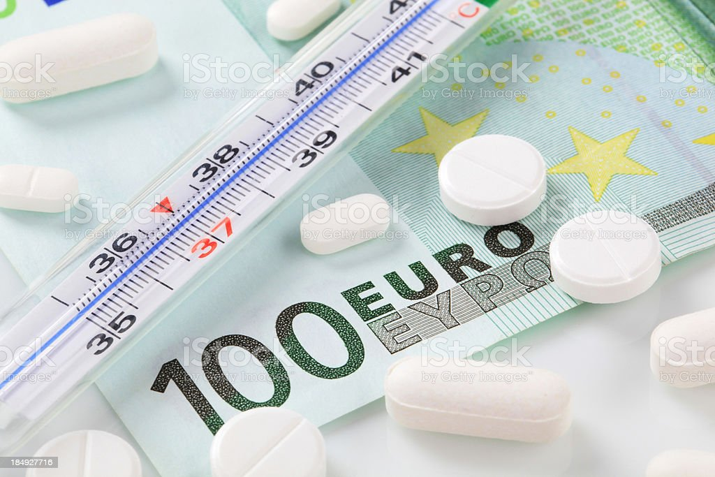 Pills, money and thermometer royalty-free stock photo