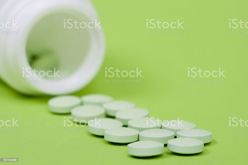 pills on green background royalty-free stock photo