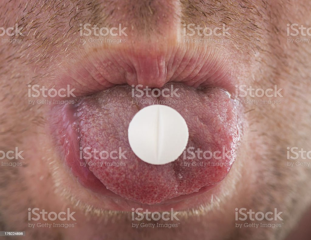 pills on human tongue royalty-free stock photo