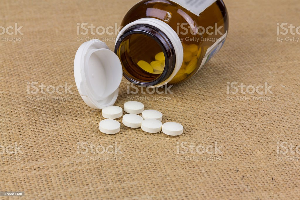 Pills on sack fabric royalty-free stock photo