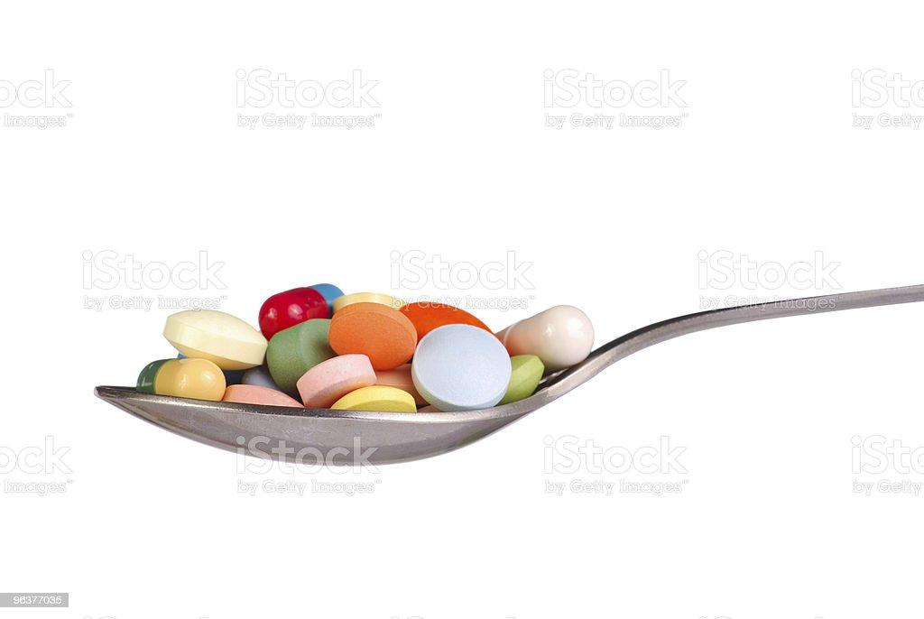Pills on Spoon royalty-free stock photo