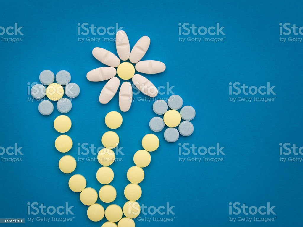 pills on the blue background royalty-free stock photo