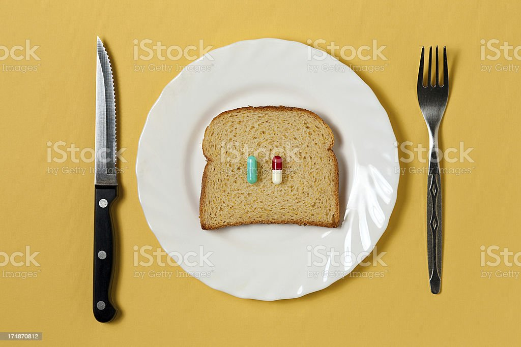 Pills on toast breakfast royalty-free stock photo