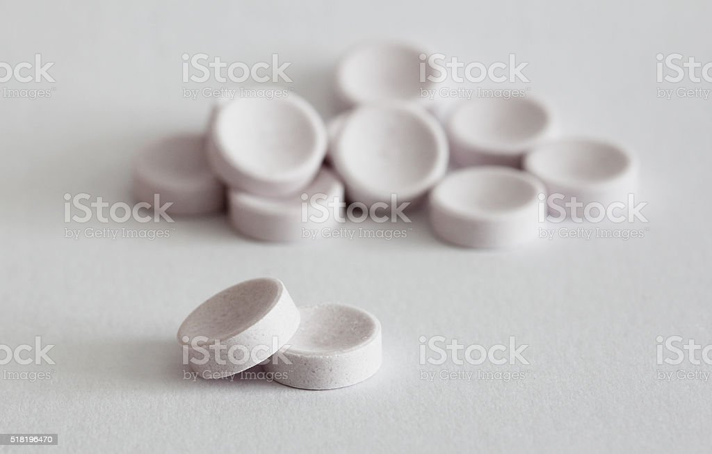 Pills on white stock photo