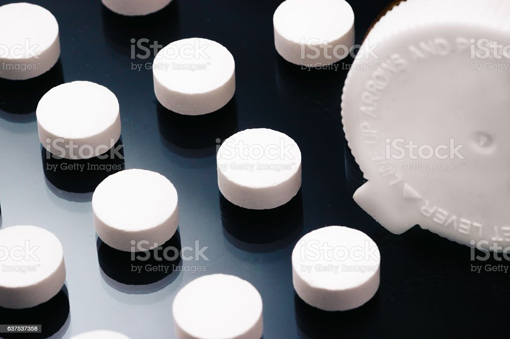 Pills organized and arranged into a pattern safety cap stock photo