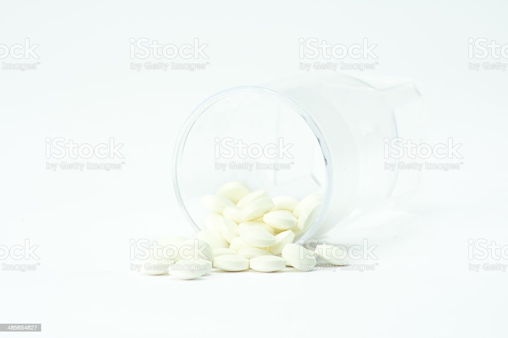 pills out of container royalty-free stock photo