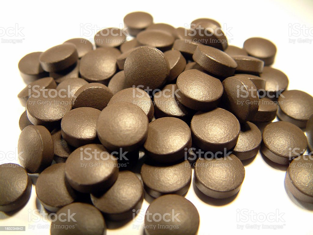 Pills (brown) stock photo