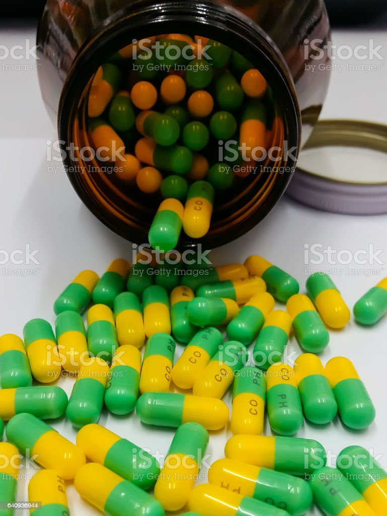 Pills pouring out of the brown bottle, Capsules and Medicine Bottle stock photo