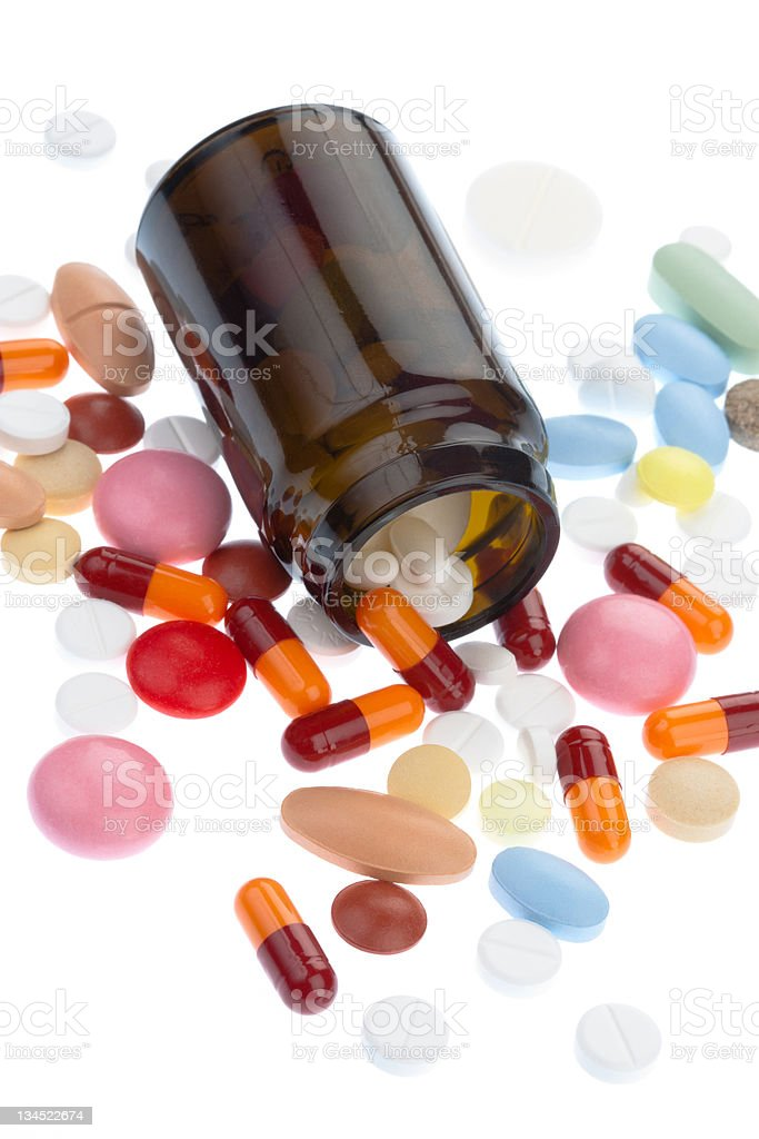 Pills pouring out of the brown bottle royalty-free stock photo