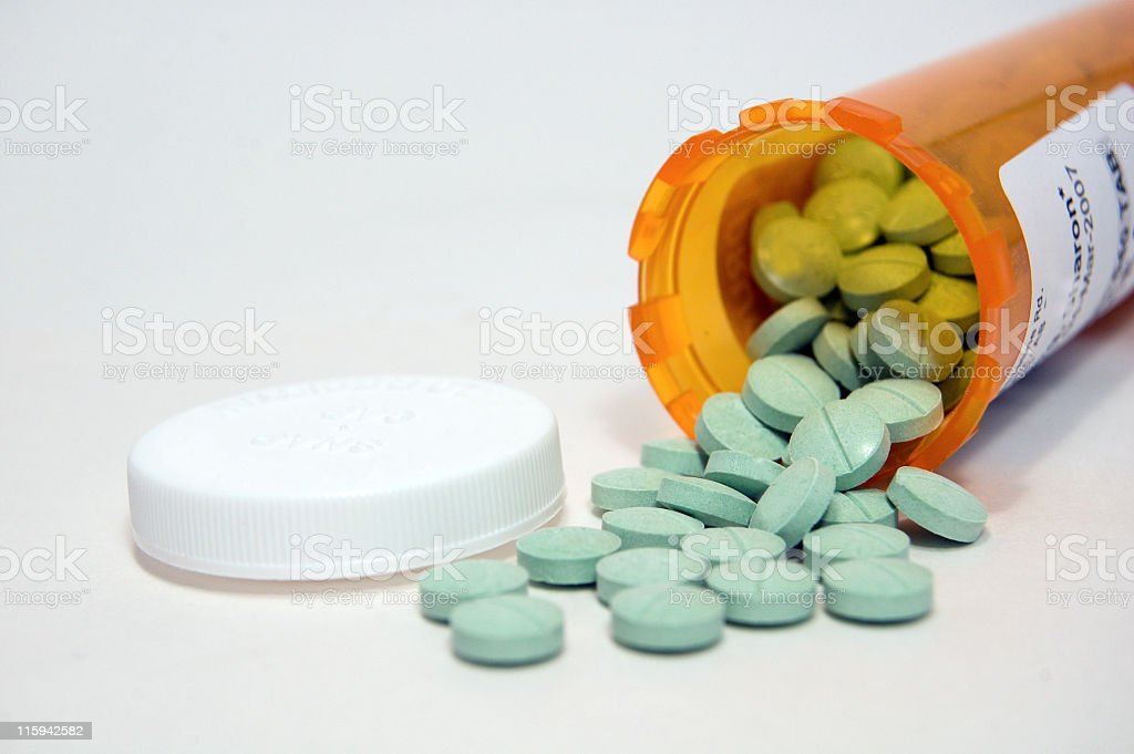 Pills Spilled From a Prescription Bottle stock photo