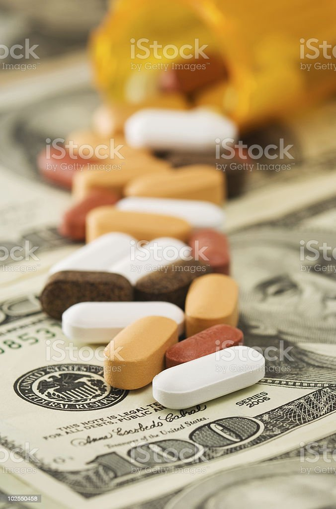 Pills spilled over money royalty-free stock photo