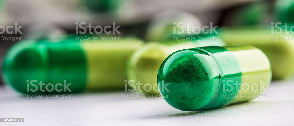 Pills. Tablets. Capsule. Heap of pills. Medical background. stock photo