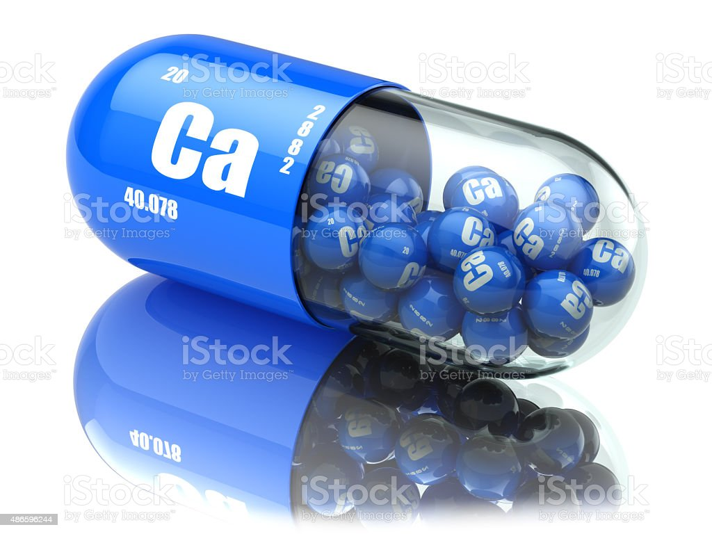 Pills with calcio CA element Dietary supplements. Vitamin capsul stock photo