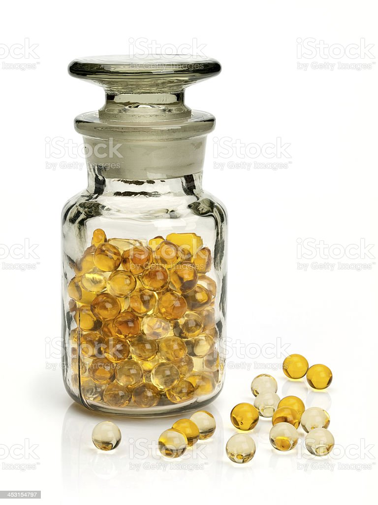 Pills with cod-liver oil stock photo