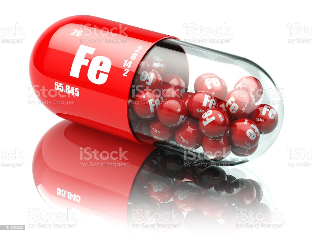 Pills with iron FE element Dietary supplements. Vitamin capsules stock photo