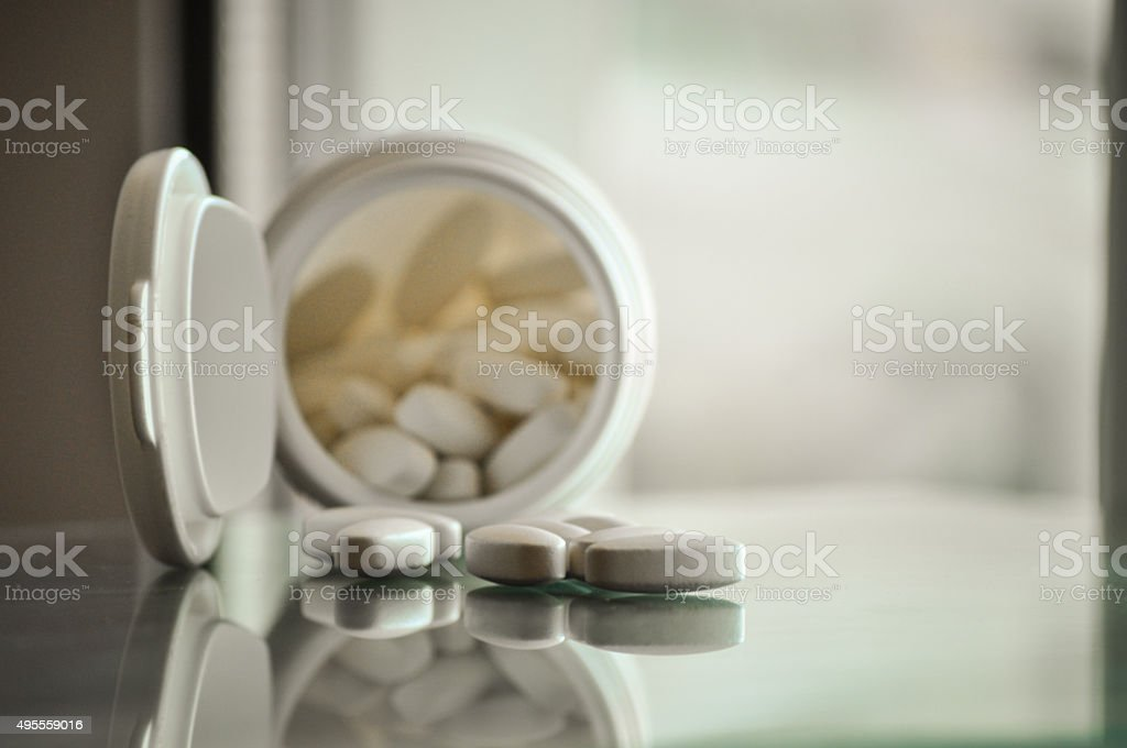 pills with pill bottle stock photo
