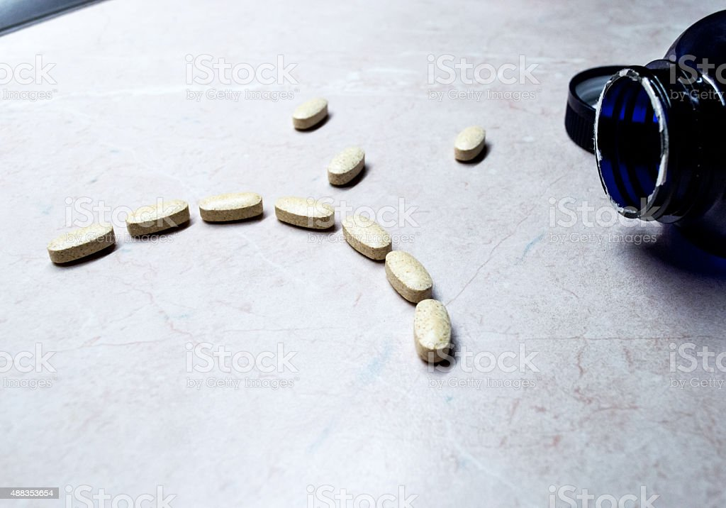 Pills/Tablets in an Unhappy/Sad Face Side View royalty-free stock photo