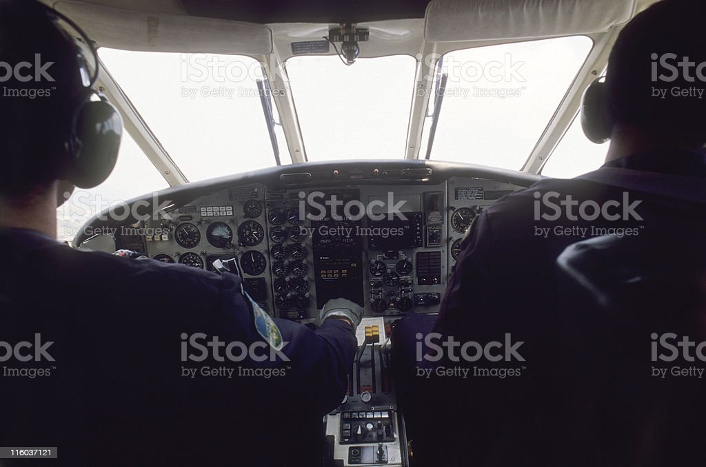 Pilot and co-pilot at work royalty-free stock photo
