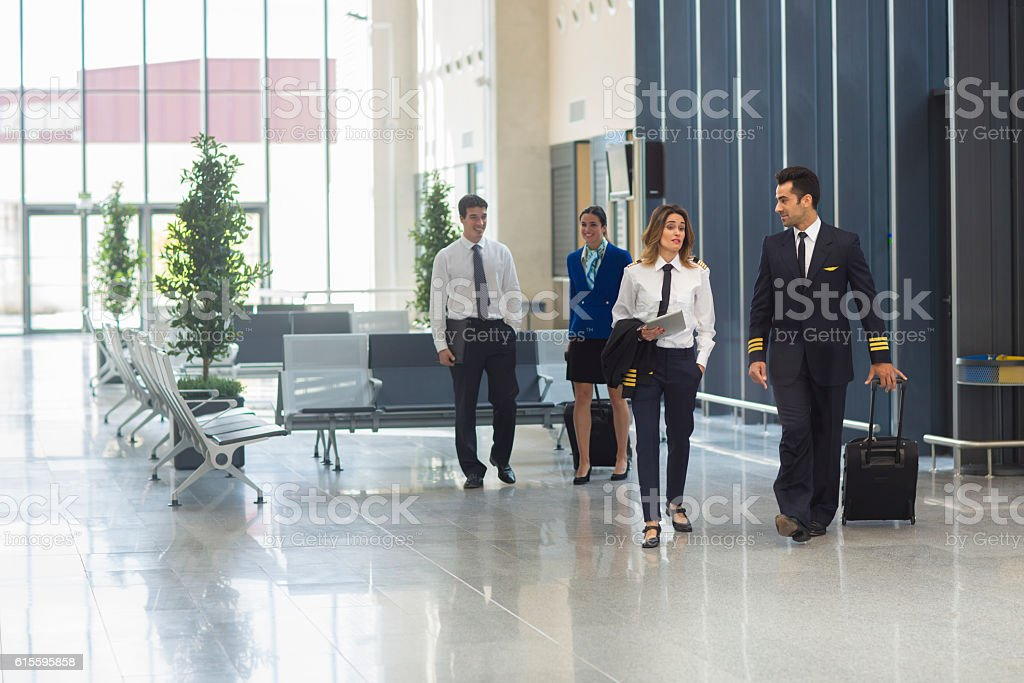 Pilot and crew on their way home stock photo
