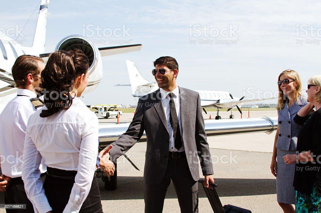 Pilot and passenger shake hands stock photo
