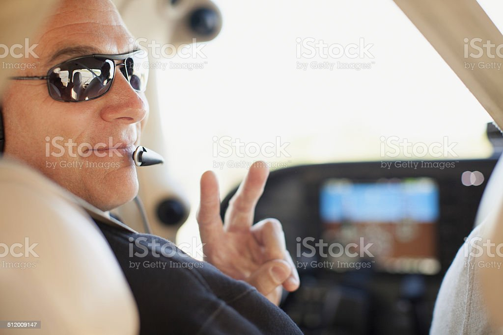 Pilot and Peace Sign stock photo