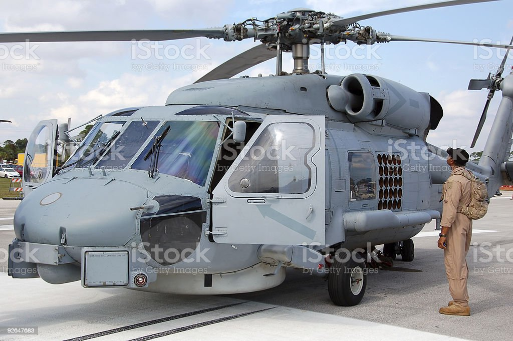 Pilot approaching navy helicopter stock photo
