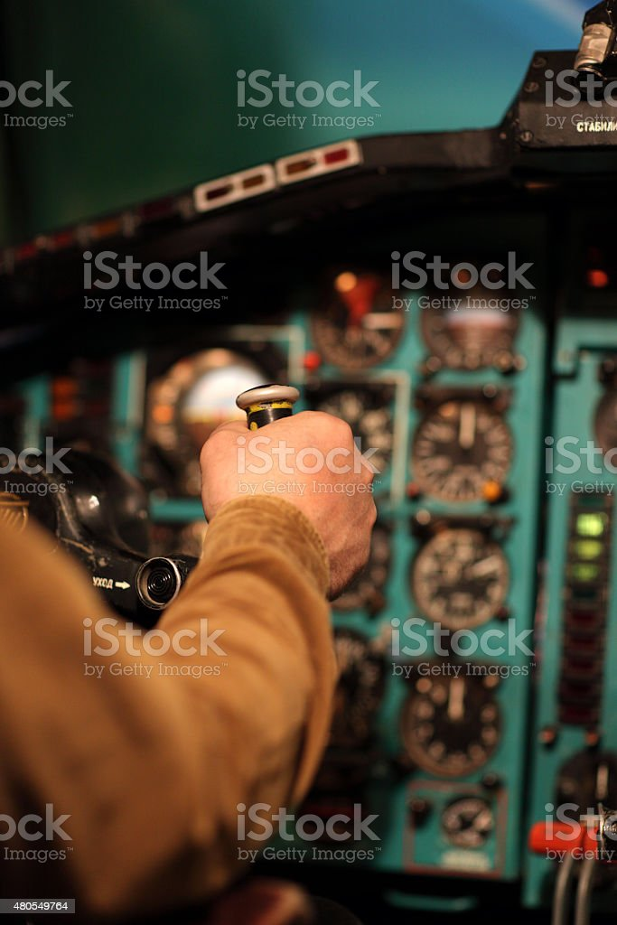 Pilot aviates by control column stock photo