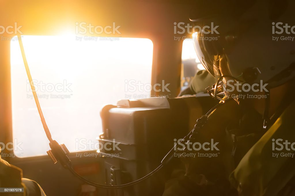 Pilot board operator with helmet and comunication harness stock photo
