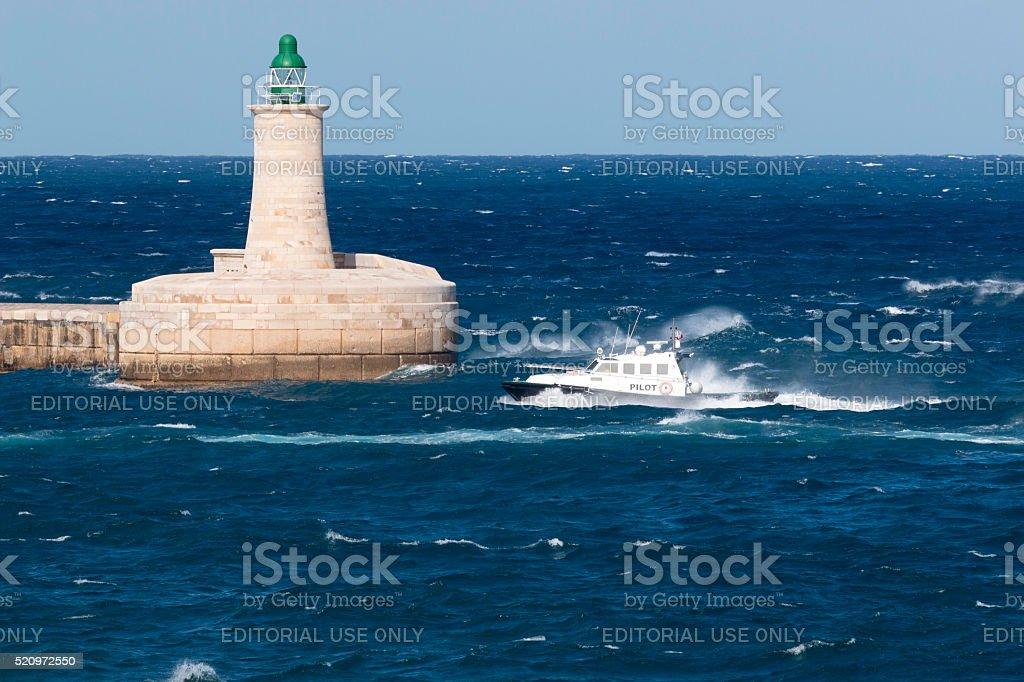 Pilot boat in rough seas stock photo