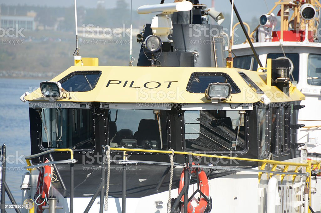 Pilot boat to bring ships into a harbor and docks stock photo
