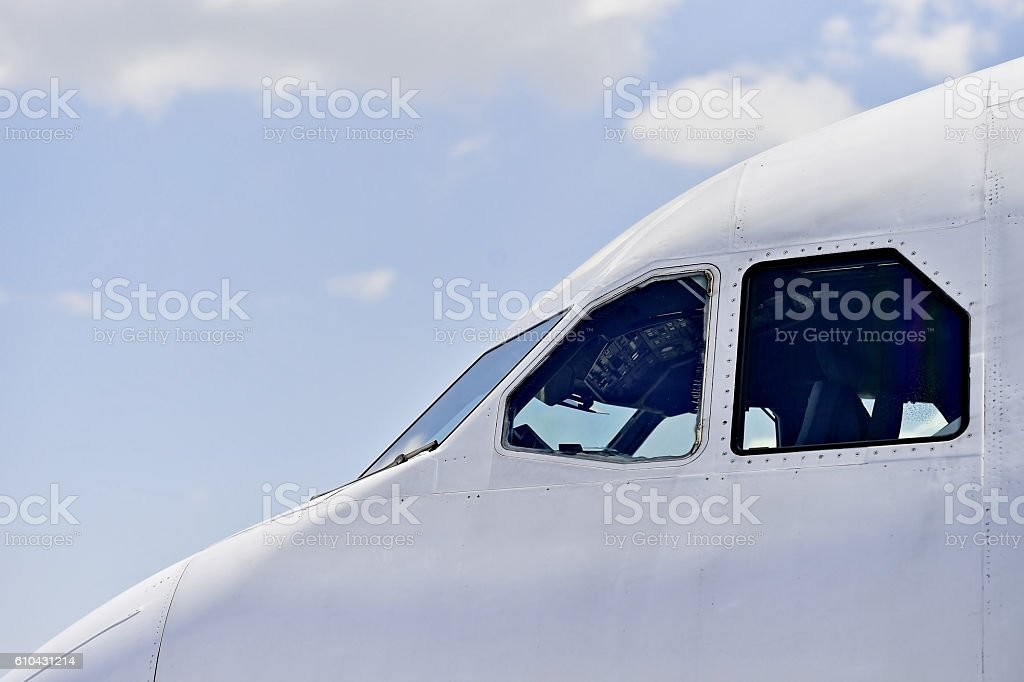 Pilot cockpit seen from outside airplane stock photo