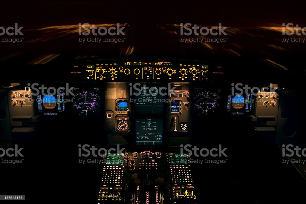 Pilot dashboard during a night flight stock photo