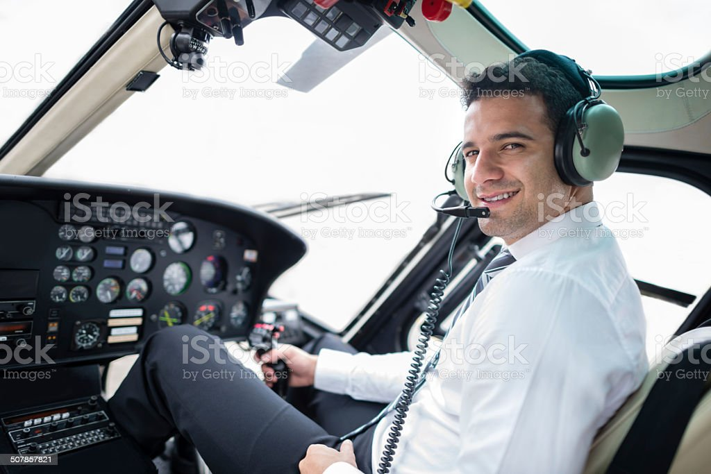 Pilot flying a helicopter stock photo