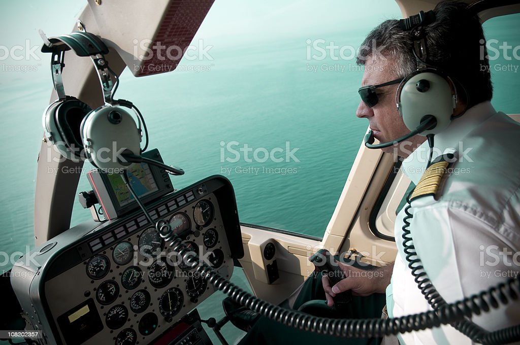 Pilot Flying Airplane with View of Ocean from Cockpit royalty-free stock photo