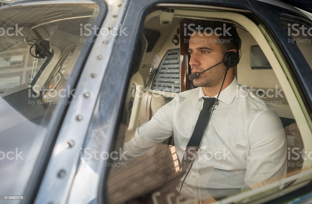 Pilot flying an airplane stock photo