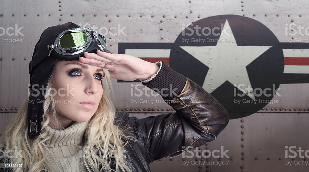 Pilot Girl with Retro Equipment Next to US Aircraft stock photo
