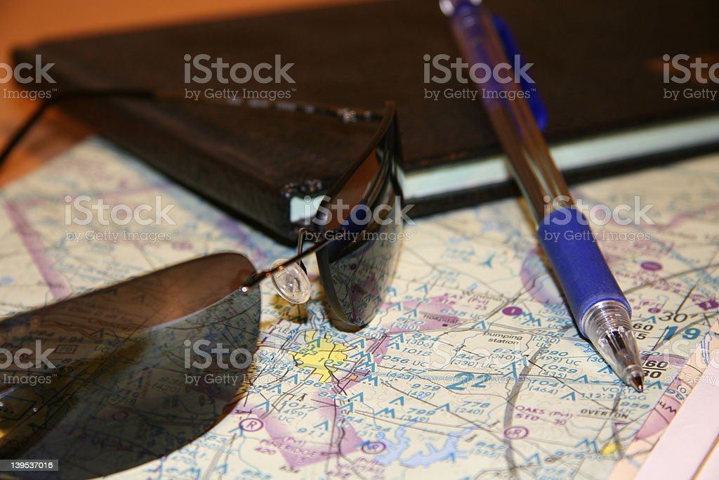 Pilot glasses a map and pilot loggbook stock photo