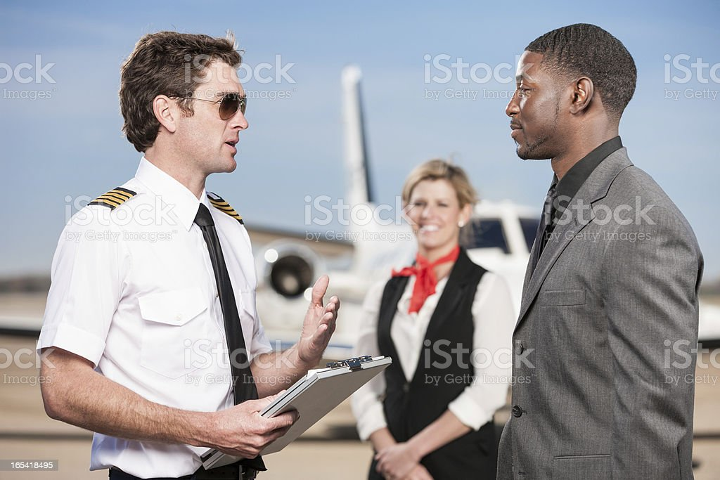 Pilot Going Over Flight Plan with Corporate Passenger stock photo