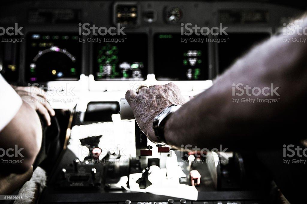 Pilot hand on thrust lever stock photo
