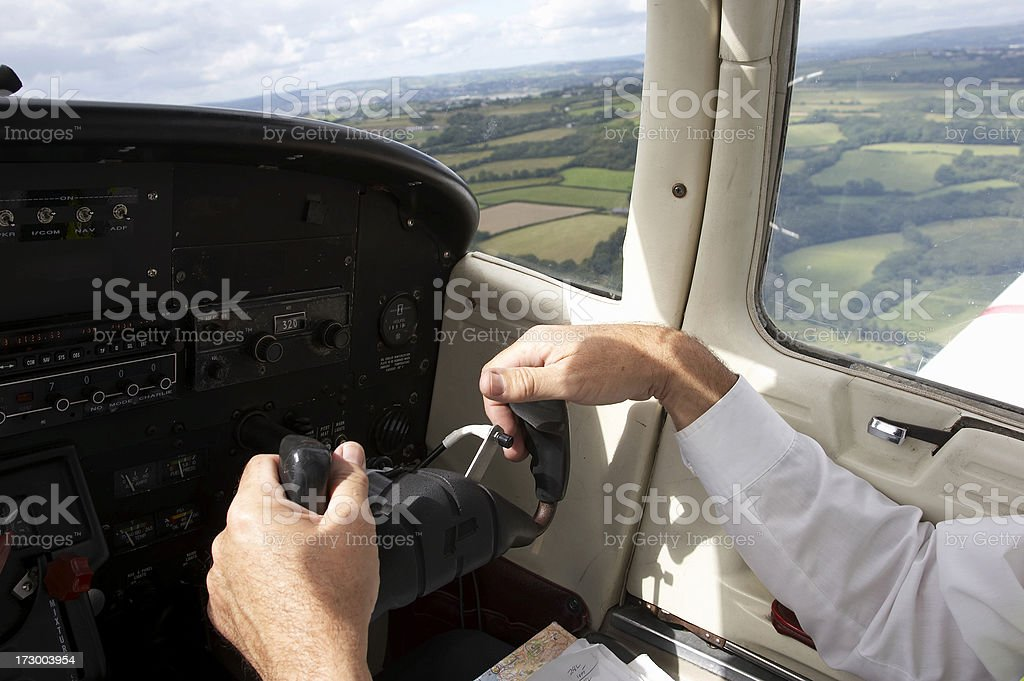 Pilot hands flying light aircraft royalty-free stock photo