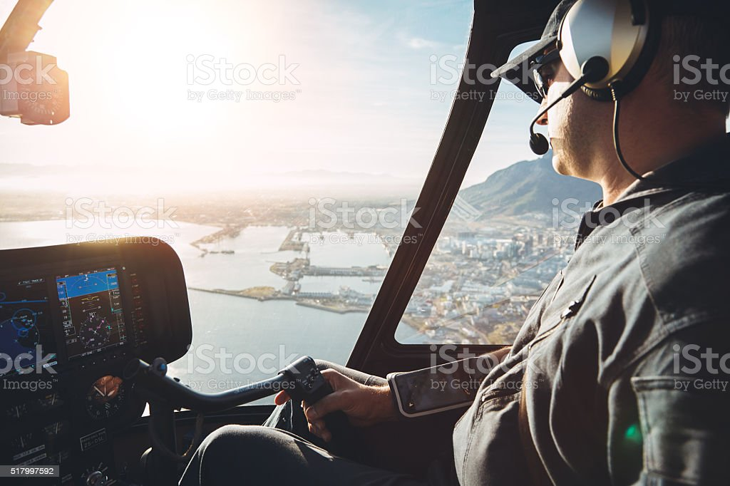 Pilot in cockpit of a helicopter stock photo