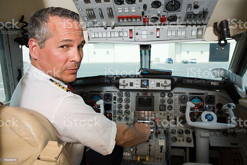 Pilot in cockpit stock photo