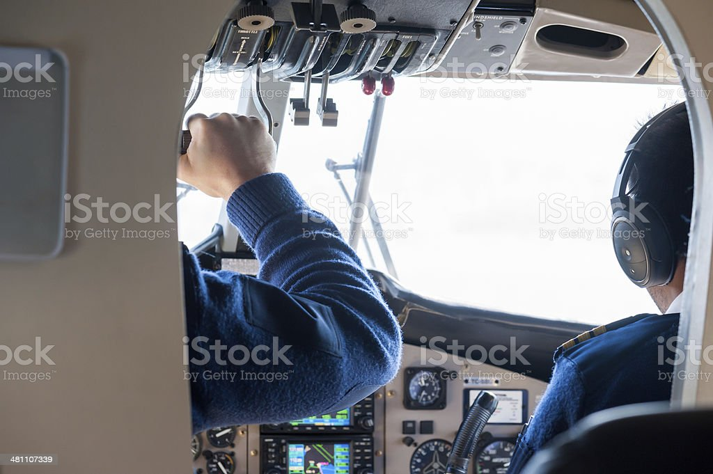 Pilot in Cockpit preparing for Take Off royalty-free stock photo